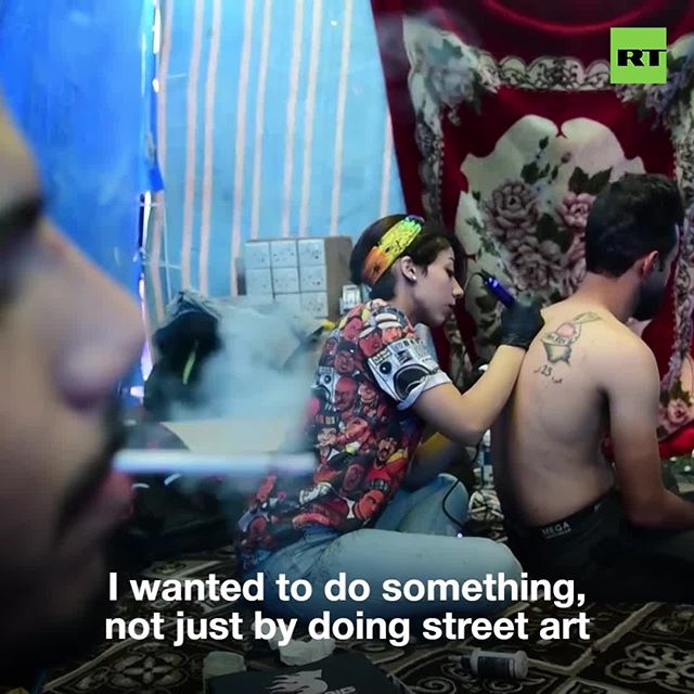 Baghdad artist Maram Odai offers protest-themed tattoos amid ongoing unrest