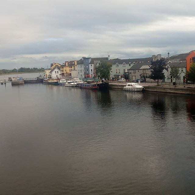 Athlone why are all the house's different colors  #photography #town #river #boat #photos #sky #storms #reflection #bridge #athlone #water #landscape #urban #Ireland #trees