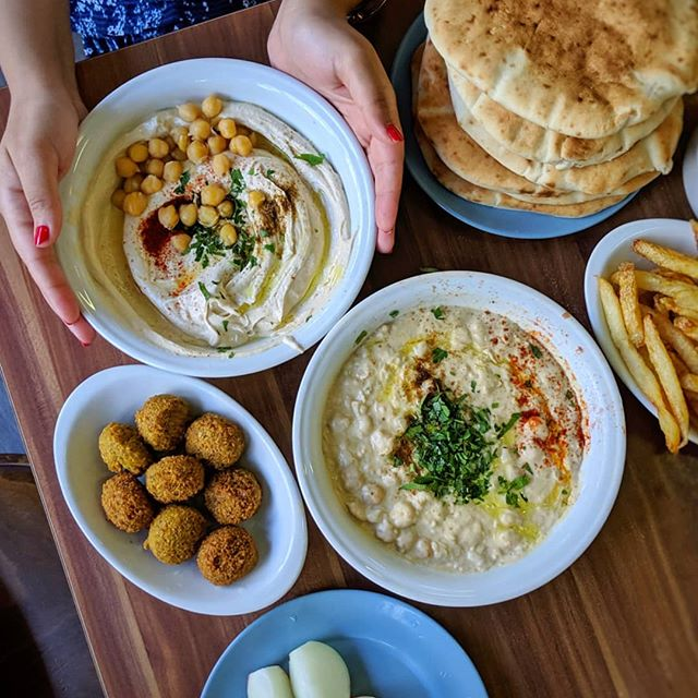 Been eating my body weight in #hummus over the past few days... 🌞🌴😋 || Here are some tips & highlights for anyone travelling to TEL AVIV: ✓ Abu Hassan for hummus & felafels (the hummus from Shlomo & Doron @ Carmel Market is also brilliant), ✓ Cafe Puaa for brunch (really cute alfresco spot), ✓ Port Said for THE BEST lunch (incredible aubergine... plus the EPIC chicken sandwich, everything is great there), ✓ Miznon for the aubergine sabiche (and hands down the best pita), ✓ Mashya for a modern twist on Middle Eastern classics (pre book in advance), ✓ North Abraxas for delicious lamb buns, ✓ Dalida for the spicy feta brulee, ✓ Opa for Vegan Cafe vibes, ✓ Imperial Bar for great cocktails (we also liked drinks @ The Butler), ✓ Anita Gelato for dessert, ✓ Yaffa Knafeh כנאפה יפו for the freshly made Knafeh (be prepared to queue!), ✓ Ramano & Teder FM for fun late night vibes, ✓Jimmy Who for a bit of dancing & a rooftop party, ✓ Arias Machne Yehuda for THE MOST INSANELY DELICIOUS midnight snacks (just go!)... ✓ Plus recovery & chill time with cocktails on the beach & fresh watermelon slices in the sun @ Frishman Beach || Also loved our day trip to JERUSALEM: ✓ visit the Mach Neyuda food market for... ✓ the best Tahina (look out for the guy who makes it fresh daily), ✓ all the local cheeses, ✓ tonnes of halva, ✓ definitely drink the fresh pomegranate juice, ✓ make a booking @ MechneYuda restaurant for lunch (from the guy behind The Palomar & The Barbary), ✓ ...plus try to save a few hours to visit the Old Town & Western Wall (try to find a local guide... really wished we could've stayed longer!!) || BTW: If you want these places to automatically appear on your Google Maps for free, simply hit up the link in my bio & FOLLOW my updated CB's Hot List (#NotAPressTrip) ✈️🙏🏻✨ . . Thank you for the tips @_corinnea || Brilliant company with @karynabajaj @aditidugar & friends ❤️ #CB_Travels #GoogleMaps #SuitcaseTravels