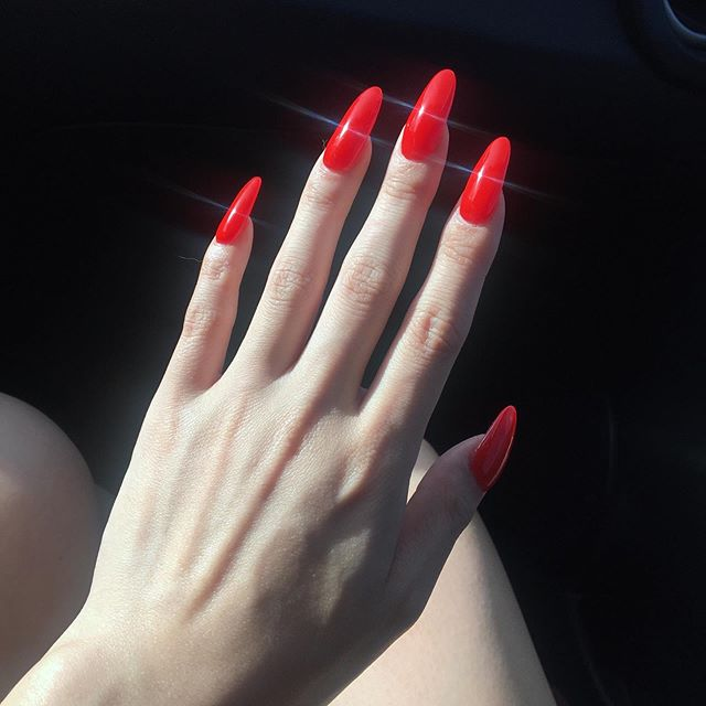 A Girl with long bright red nails = don't you ever stop me