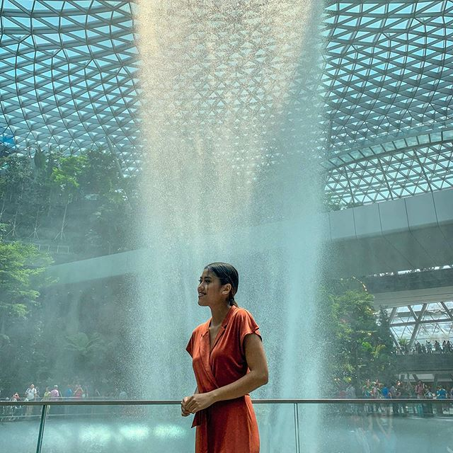 At the world's best airport with the world's tallest indoor waterfall behind me ✨