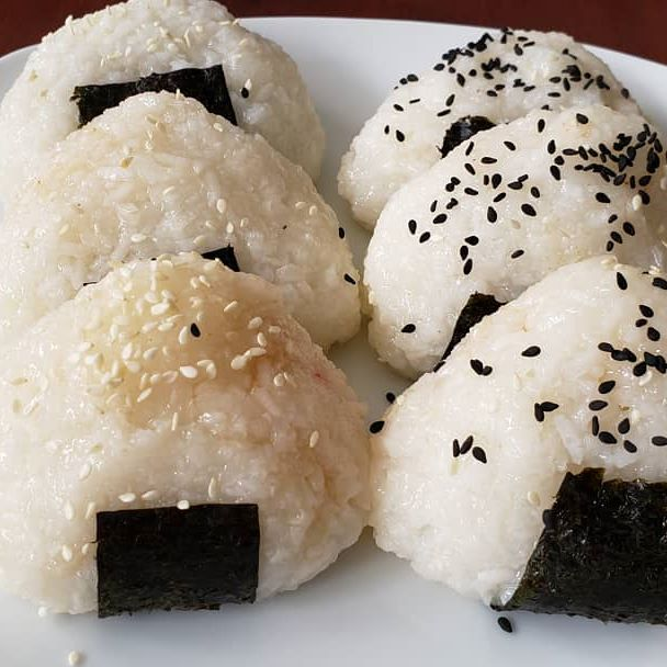 Onigiri made with two different kinds of vegetarian fillings. Roasted sweet potatoes and cooked zucchini. Recipe on my YouTube channel. Link in bio. #onigiri #riceballs #vegetarianrecipes #japanesefood #homemade #newyoutubevideo #eatmorevegetables #easysnack #recipes