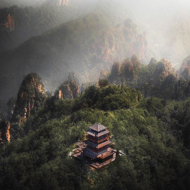Magical scenery deep in the Hunan mountains 🍃 This whole region was absolutely breathtaking, those ancient architects certainly picked a great spot to build a temple! . . . . . #trappingtones #outside_project #wonderful_places #wildernesstones #weroamgermany #liveadventurously #theworldshotz #duskmac #ourmoodydays #fromwhereIdrone #discovernature #VisualMobs #findyouradventure #roamtheplanet #roam @folkgreen #theglobewanderer #liveforthestory #hubs_united #theactiveway #neuehorizonte #dscvr_earth #moodygrams #folkscenery #artofvisuals #nikond850 #globeshotz #discoverer #folk_life_mood #illgrammers #lifeklub