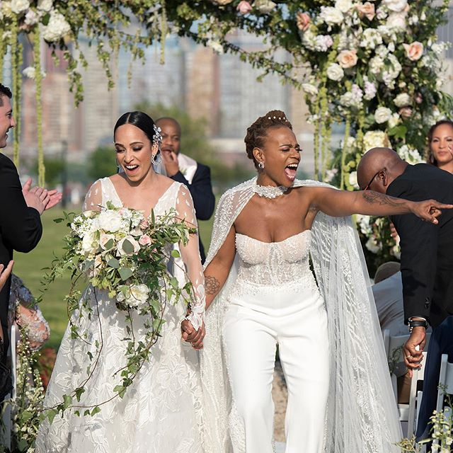 These brides met because of #Beyonce and yes, their wedding was as epic as you can imagine. Link in bio for the feature! | Photo: @studioaimages | Planning: @tkeventsnyc | Venue: @libertyhouserestaurant | Dress Designer: @leegrebenau | Floral Designer: @brideandblossom | Lighting: @pegasusproductions | String Quartet: @sterlingstringsnyc | Dress Salon: @spinabride | Shoes: @nicholaskirkwood and @sophiawebster | Hairstyling: @tarbabyhairdesign | Makeup: @kittykatnejat | Cake Design: @palermosbakery | Donut Wall: @off_the_wall_donuts⁠⠀ .⁠⠀ .⁠⠀ .⁠⠀ #realwedding #loveinc #equalitymindedweddings #nycwedding #njwedding #nycweddingphotographer #njweddingphotographer #nycweddingplanner #njweddingplanner #weddingideas #weddinginspiration #engaged #bridal #bridalstyle #weddingdress #bridalfashion #samesexwedding #lgbtwedding #gaywedding #lgbtqwedding #lesbianwedding #weddingstyle #weddinginspo #epicwedding #loveislove #lovewins #bride