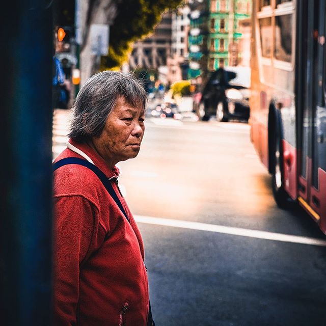 TRANQUILITY 🎍🌛🧘🏼♀️ // A woman is peacefully waiting at a crosswalk. She holds her head up high with positive energy despite being in a rush for work. Suddenly, her eyes become fixated on something in the distance: a public transit bus crowded with daily commuters. Staring back at the woman is a young boy whose delicate hands press against the glass windows of the bus. He aspires to make a pivotal change in today's society. The woman believes in the boy's vision and desires to make an impact as well. However, despite having strong ambitions, she knows that time is the largest obstacle holding her back. As the boy in the bus drifts away, the woman becomes demoralized and engulfed by depression. Yet just when all hope seems lost, the boy looks back for a brief moment, playfully smiling at the woman. His cheerful spirit rejuvenates the woman back to her upbeat self and reassures her that she is still capable of achieving her dreams. • • • • • • • • •  #moodygrams #wildbayarea #streetsofsf #alwaysSF #nowrongwaysf #bay_shooters #artofvisuals #visualambassadors #tonekillers #fatalframes10k #weekly_feature #theimaged #bestofbayarea #cityunit #streetmagazines #beautifuldestinations #depthsofearth #shotzdelight #uas10k #agameof10k #aov5k #creativeoptic #filmtronic #moodyaperture #streets_vision #canonphotos #citygrammers #streetclassics #streetframe #rawurbanshots