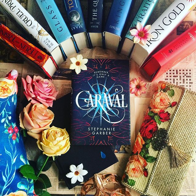 """It's #bookreviewsaturday 🎩 #QOTD : Tell me all your fave morally grey or villain-not-so-villain kind of characters! I would love to meet more of them 🖤 • Mine are definitely The Darkling, Maven, Cardan, Kaz, and Legend 🎩 (I want to include Rhysand, but I'm not sure if he's one of them 🤔) • Today I'm reviewing Caraval ⭐️⭐️⭐️⭐️, after so many people recommend this series to me 😉🎩 Welcome to the game, and here are my mini review points: • 1. The story was about two sisters, Scarlett and Donatella Dragna who've been fans of Caraval game play by the mysterious Master Legend since they were lil girls 🖤 Left by their mom and live with their abusive father, Scarlett keep sending letters to Legend (never once being answered by him) until on her last letter before she was giving up, she was stating that she'll get married soon with a Count (whom she's never meet before) and if Legend will give her and Donatella a chance in joining his game 🖤 Surprisingly, Legend answered the letter and invite them to the game on his private island. Not only that, he'll give """"One Wish"""" as the prize for one winner! Sounds exciting, right? But soon Scarlett realized that not all's genuinely beautiful and full of rainbows 😏🖤 Note: It was told from Scarlett 3rd POV. . 2. Until now, everytime someone asked a QOTD of """"Which fictional character do you most related to?"""" I always struggled to answer that, but now I can say that I can relate to Scarlett (for some parts, at least) like for example she's often worried about lots of things (I suffer from anxiety, alright 😌), but she cared and want to protect her loved ones, she wants love and protection, and even though she's not saying it out loud, she also wants to live her dreams and have freedom of choices 🖤 . 3. Talk about romance.. I love that despite Julian (my newest Cinnamon Roll) was jokingly teasing Scarlett from the beginning, but it's still a slow-burn romance! (I wont tell the details 😚) . 4. The plot fits for you (and me) who love riddles, m"""