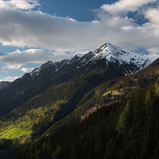 """🏔 """"Austrian Valley"""" - Back in the beautiful Austrian Alps a few weeks ago. This time for a special mission. It was a quiet evening on a hill, just high enough to overlook the beautiful valley, which was hit by spots of light from now and then. We planned to photograph the snow covered peak on the other side of the valley. A mountain, where a good friend had a very special day. . . . . . . . #visitaustria #tirol #austrianalps #lovetirol #mountainlover #NatGeoDE #nikondeutschland #southtyrol #nikoneurope #benro #roamtheplanet  #bestmountainartists #austria #shotzdelight #earthofficial #earth_shotz #mountainstories #mountainstones #earthoutdoors #mthrworld #outdoortones #earthcapture #mylpguide @bbc_travel  @natgeotravel @nature.geography"""