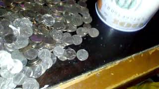 saving coins 1and 5 dollar bills after 2 years