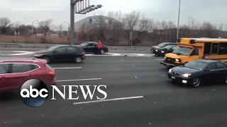 Drivers clamor for cash spilling out of armored truck