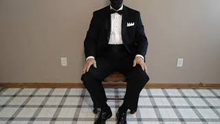 Seated in my Calvin Klein video showing I'm wearing classic men's sock garters.