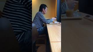 An annoying person listening to music at a loud volume Doutor coffee at the Kyoto Shijyo Bridge