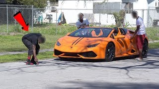 LAMBORGHINI BAIT CAR IN THE HOOD!! ELECTRIC SEAT PRANK! GONE TERRIBLY WRONG!!!